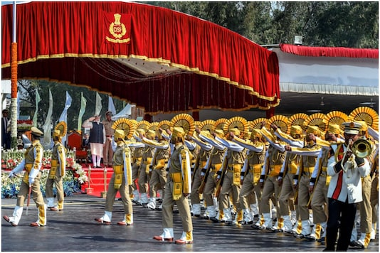A contingent offers salute to Prime Minister Narendra Modi as he reviews the CISF's 50th Raising Day parade, in Ghaziabad in 2019. (PTI)