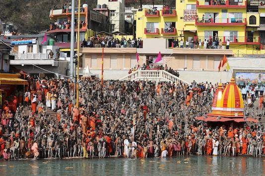 "Naga Sadhus take a dip at Ganga river at ""Kumbh Mela"" in Haridwar. (Reuters)"