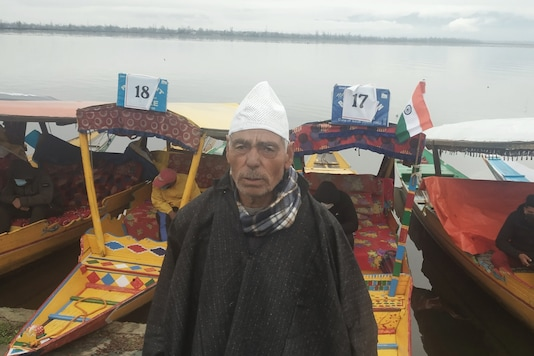 Boatman Nabi Ghulam  hopes for a turnout in his business.