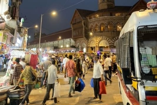 A look at South Mumbai's landmark Crawford market area shows what the city is like on an average evening despite the daily spike in cases. Social distancing is next to impossible.