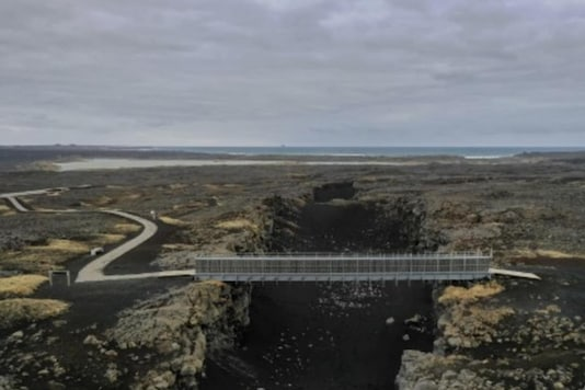 "Aerial view taken on February 28, 2021 shows the ""Bridge between Continents"", a footbridge linking the Eurasian and North American tectonic plates, near the town of Grindavik on the Reykjanes peninsula, Iceland, some 50 kilometres west of the capital Reykjavik, atop the Mid- Atlantic Ridge, one of the three most seismically active areas on the planet. (AFP Photo)"