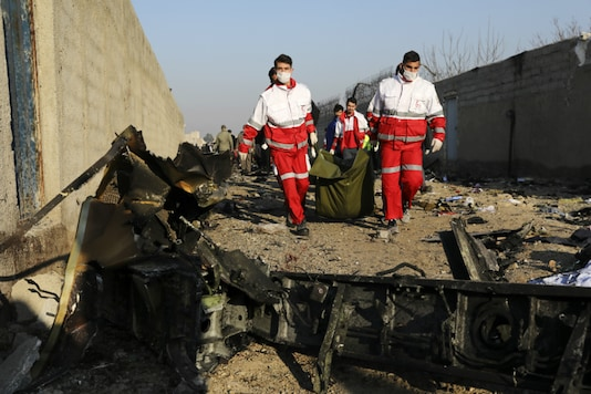 Rescue workers at the site of the crash. (Image source: AP)