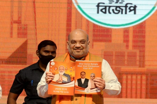 Amit Shah releases party's 'Sankalp Patra' in Kolkata on Sunday.