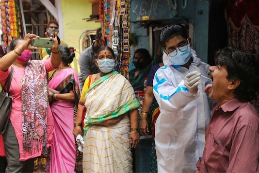 A health worker collects a swab from a man in Mumbai. (Reuters)
