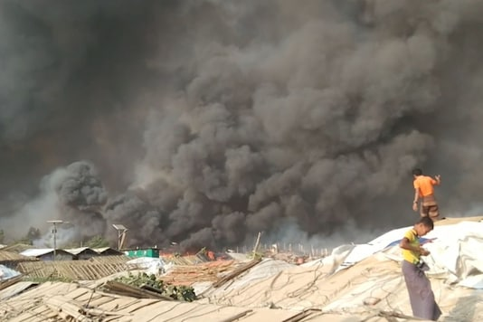 Smoke is seen at Balukhali Refugee Camp, in Cox's Bazar, Bangladesh, March 22, 2021. Via REUTERS