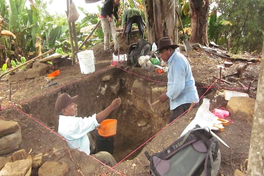 Members of the local community working with a team of archaeologists share finds during excavations at the ancient Maya site of Uxbenka, Belize.  Keith Prufer/Handout via REUTERS