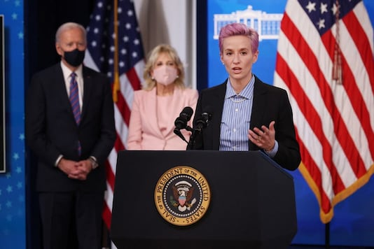 Megan Rapinoe delivers remarks during and event to mark Equal Pay Day with U.S. President Joe Biden (L) and first lady Dr. Jill Biden in the South Court Auditorium in the Eisenhower Executive Office Building (Photo Credit: AFP)