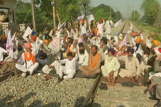 Protestors block railway track in Amritsar as a mark of protest against the three agricultural laws during 'Bharat Bandh' called by Samyukt Kisan Morcha