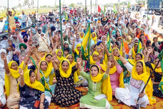 Farmers shout slogans during 'Bharat Bandh' against the Centre's new farm laws in Patiala, Friday. (PTI)