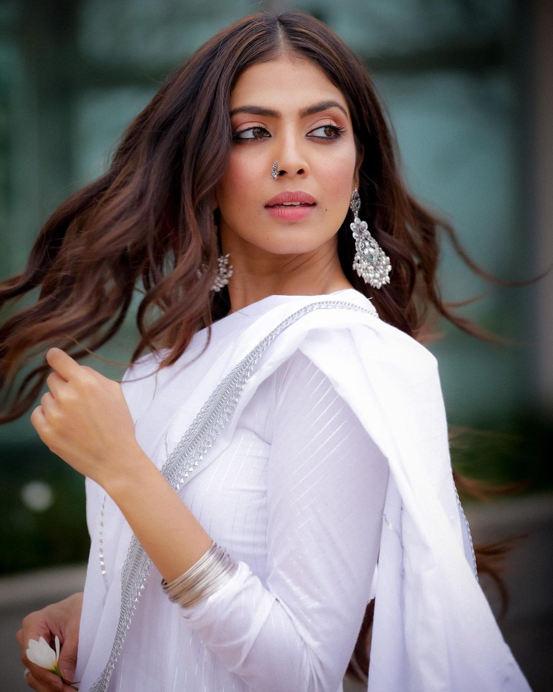 Malavika Mohanan looks graceful in the plain white suit. (Image: Instagram)