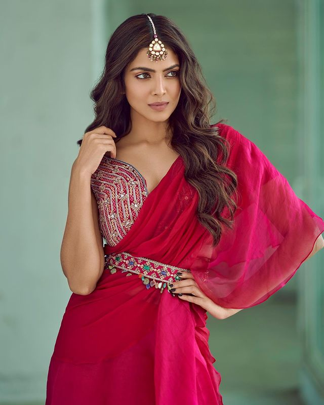 Malavika Mohanan looks ethereal in the pink saree with the embroidered blouse and belt. (Image: Instagram)