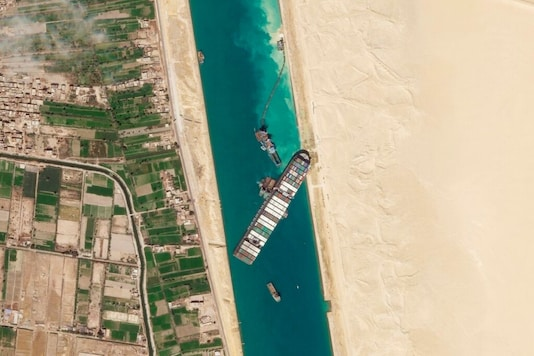 The cargo ship MV Ever Given sits stuck in the Suez Canal near Suez, Egypt. (AP)