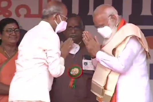 PM Narendra Modi is felicitated by BJP's Palakkad candidate E Sreedharan on Tuesday.