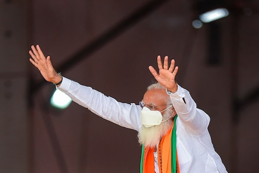 Prime Minister Narendra Modi at a public meeting in support of NDA candidates, ahead of Tamil Nadu assembly polls, at Dharapuram in Tiruppur district on Tuesday. (PTI)