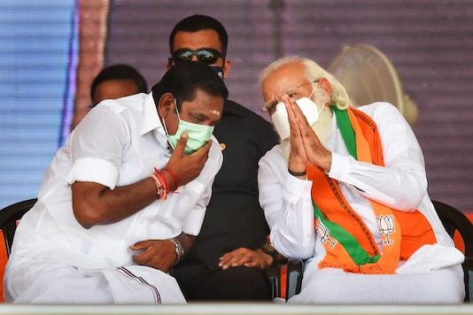 Prime Minister Narendra Modi with Tamil Nadu CM Edappadi K Palaniswami during a public meeting at Dharapuram in Tiruppur district. (PTI)