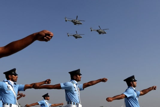 Indian Air Force (IAF) soldiers march as advanced light helicopters fly during the Indian Air Force Day celebrations at the Hindon Air Force Station on the outskirts of New Delhi, India, October 8, 2019. (Reuters)
