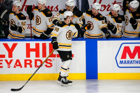 The Latest: Bruins To Return From COVID Pause On Thursday