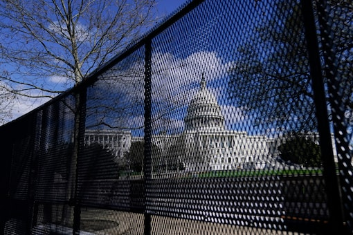 The U.S. Capitol is seen behind security fencing after a car that crashed into a barrier on Capitol Hill in Washington, Friday, April 2, 2021. (AP Photo)