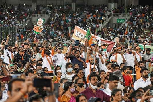 Thiruvananthapuram: BJP supporters as Prime Minister Narendra Modi waves the crowd at the Greenfield International Stadium, during an election campaign for the Kerala Assembly polls, in Thiruvananthapuram, Friday, April 2, 2021. (PTI Photo)(