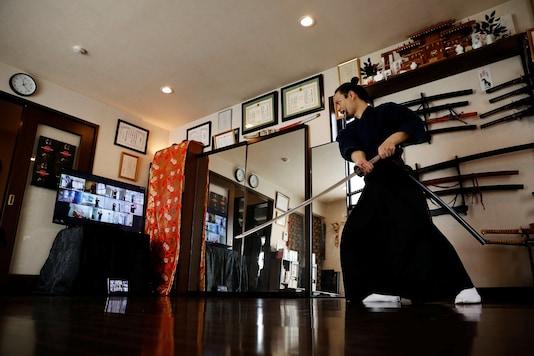 The founder of Bugaku and Samurai martial arts instructor Koshiro Minamoto demonstrates martial arts during an online class.   REUTERS/Kim Kyung-Hoon