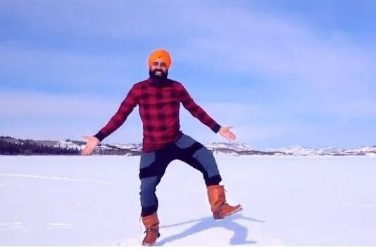 Video grab of Canadian artist doing bhangra on frozen lake after receiving covid vaccine.  (Credit: Twitter)