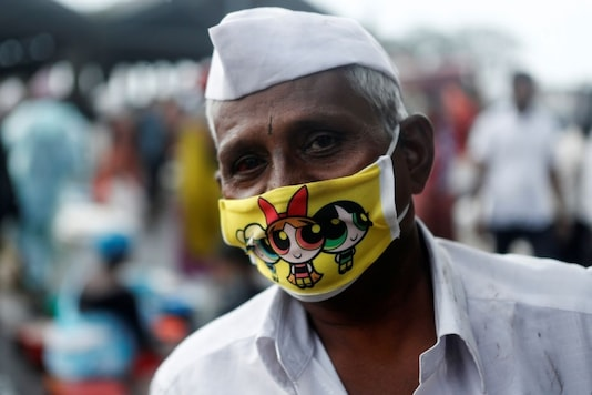A fisherman wearing a protective face mask in Mumbai. REUTERS