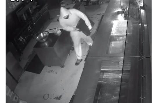 Video grab of burglar in the US restaurant.  (Credit: Facebook)
