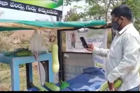 A customer making digital payment at 'Honesty Vegetables' stall in Hyderabad.