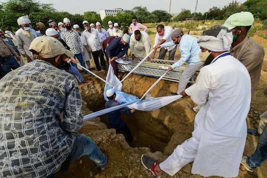 New Delhi: Burial of a person who died of COVID-19, amid a spike in coronavirus cases countrywide, at a graveyard in New Delhi, Wednesday, April 14, 2021. (PTI Photo/Kamal Kishore)(