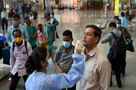 A health worker takes swab samples in Mumbai. PTI Photo