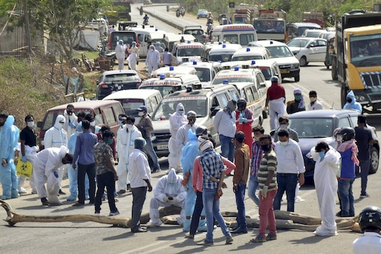 Ambulances carrying the bodies of COVID-19 victims, parked near the Ghagra Mukti Dham during a protest by drivers against alleged mismanagementin the burials of COVID-19 victims, in Ranchi on Monday. (PTI)