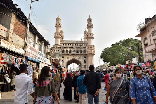 Visitors walk on a street leading to the historic Charminar in Hyderabad. (PTI)