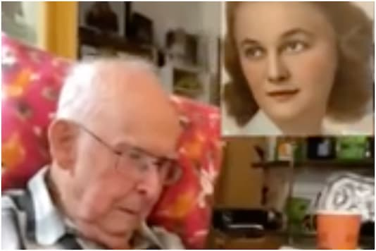 Man reacting to deceased wife's animated photo | Image credit: Reddit