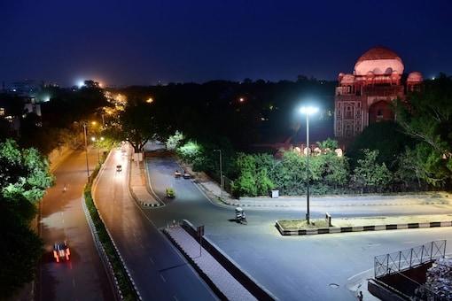 File photo of deserted streets in Delhi during lockdown. (Image: PTI)