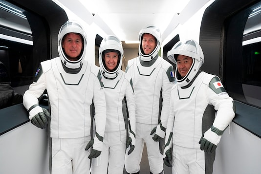 SpaceX photo shows, from left, NASA astronauts Shane Kimbrough and Megan McArthur, European Space Agency astronaut Thomas Pesquet and Japan Aerospace Exploration Agency astronaut Akihiko Hoshide.   (SpaceX via AP)