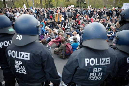 Demonstrators attend protest rally against the German government's policy on lockdown in Berlin. (AP)