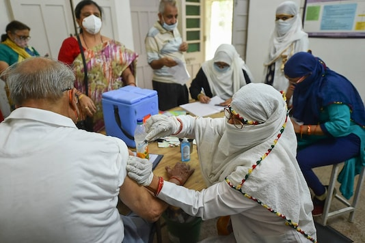 A beneficiary receives Covid-19 vaccine shot at a Covid-19 centre.