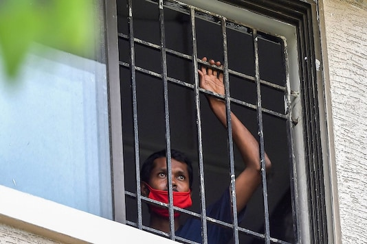 A COVID-19 positive patient looks on from the COVID care centre of the Rajiv Gandhi Government General Hospital in Chennai. (PTI)