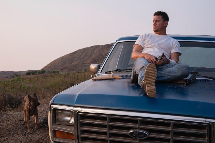 Tatum strikes the perfect post as he sits on the bonnet of his Ford. Dressed casually in a pair of blue jeans, white t-shirt and brown boots, the actor steals the show. (Image: Instagram)