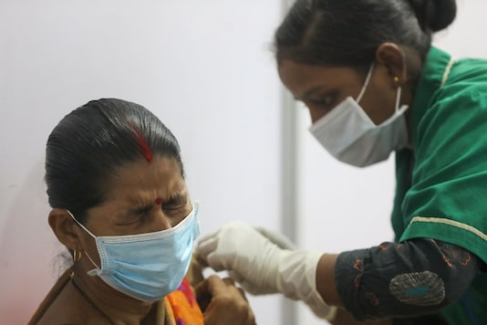 A woman receives a dose of Covishield vaccine in Mumbai. (Reuters)
