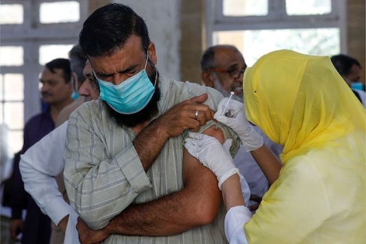A man receives a dose of the coronavirus disease (Covid-19) vaccine, at a vaccination center in Karachi, Pakistan. REUTERS