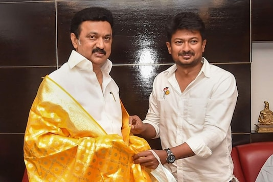 DMK youth wing secretary Udhayanidhi Stalin shares his victory with his father and party president MK Stalin after winning the Tamil Nadu Assembly polls at his residence ,in Chennai, Sunday. (PTI)