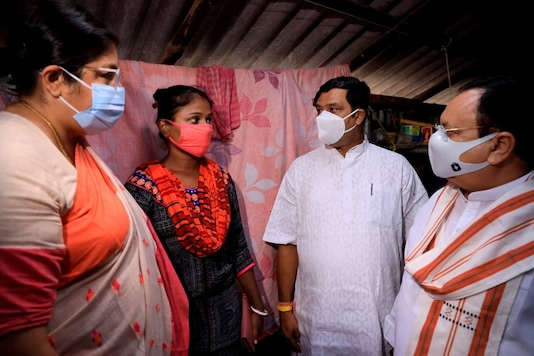 BJP national president JP Nadda with other party leaders interact with the family member of a BJP worker in Bengal on Tuesday. (PTI)