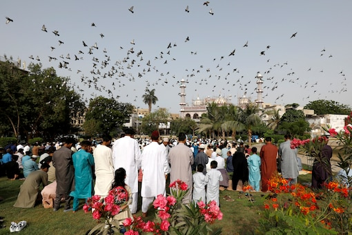 Pakistani Muslims gather to celebrate Eid al-Fitr prayers to mark the end of the holy fasting month of Ramadan, as the outbreak of the coronavirus disease (COVID-19) continues in Karachi, Pakistan May 13, 2021. (Reuters)