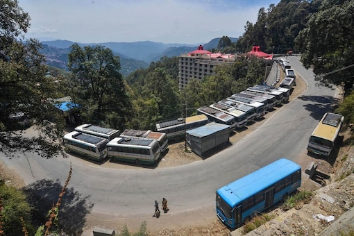 Himachal Road Transport Buses (HRTC) parked at a road side during ongoing COVID-19 curfew in Shimla, Saturday, May 15, 2021. (PTI)