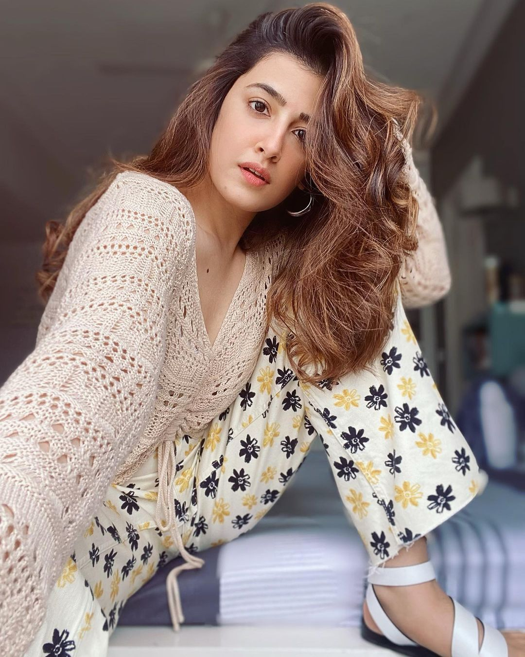 Nupur Sanon strikes a stylish pose in a corchet top and floral pants. (Image: Instagram)