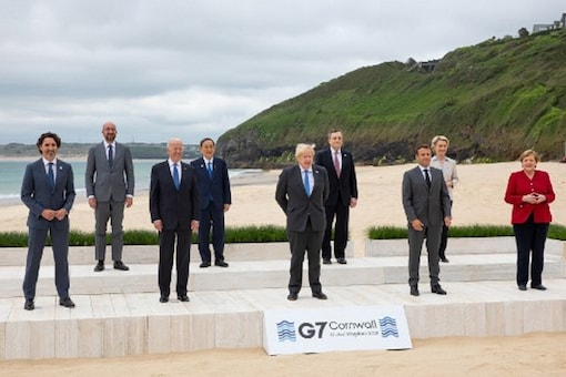 Leaders from the Group of Seven nations and the European Union pose for the family photo at the start of the G7 summit in Carbis Bay, Cornwall on June 11. (Image: AFP)