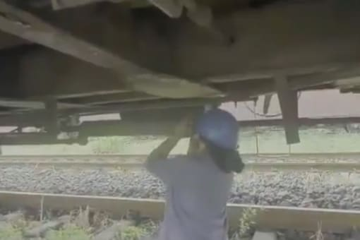 Video grab of all-woman team fixing freight trains.