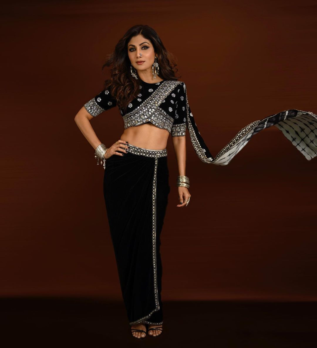 Shilpa Shetty Kundra's latest black saree look proves that she is the OG style and fitness queen of . Scroll ahead as we roundup some of her best style moments of the recent past. (Image: Instagram)