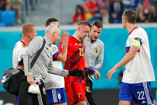 Belgium's Timothy Castagne leaves the pitch after been injured (AP)